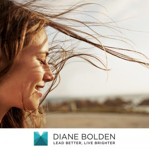 a profile image of a young woman with her hair blowing in the wind and feeling the lightening of the load